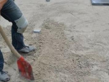 Zand en gebroken puin